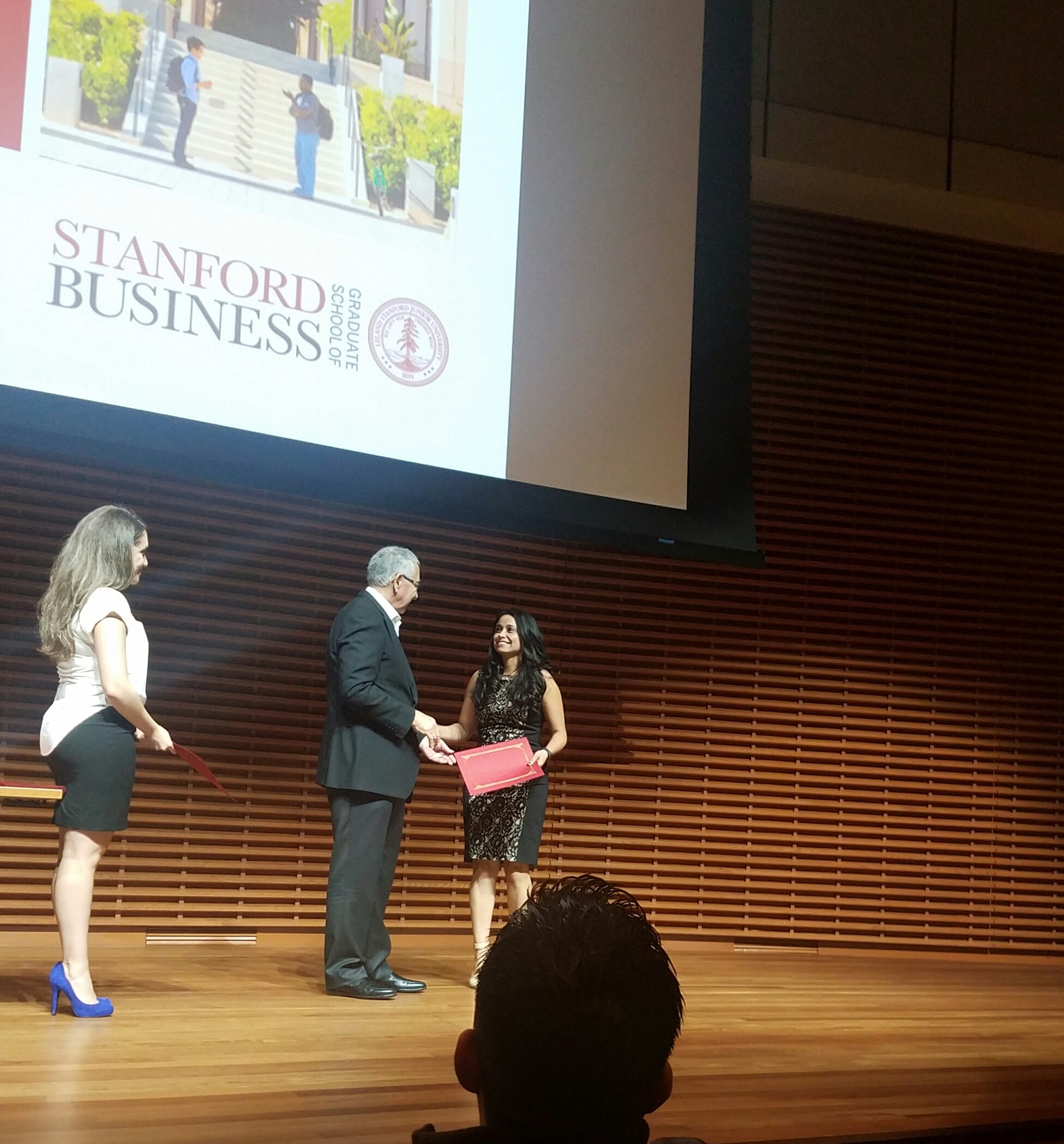Latina Technology Leader Natasha Pongonis, receiving a certification of completion from the Stanford Latino Entrepreneur Leaders Program